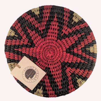 Woven grass trivet with red star design