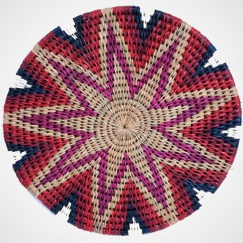 Woven grass trivet with Plum and indigo star pattern