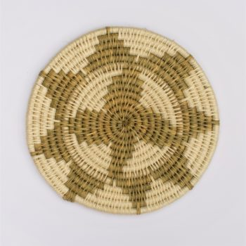 Ethical woven grass trivet with white design