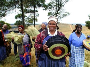 Ladies with grass and placemats in countryside
