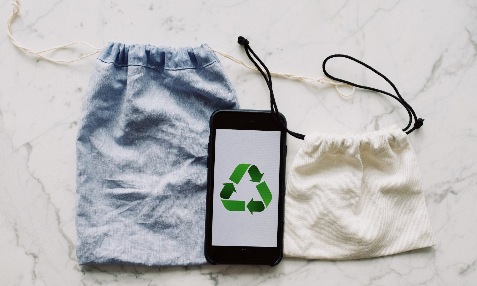 smartphone with recycling symbol on screen placed