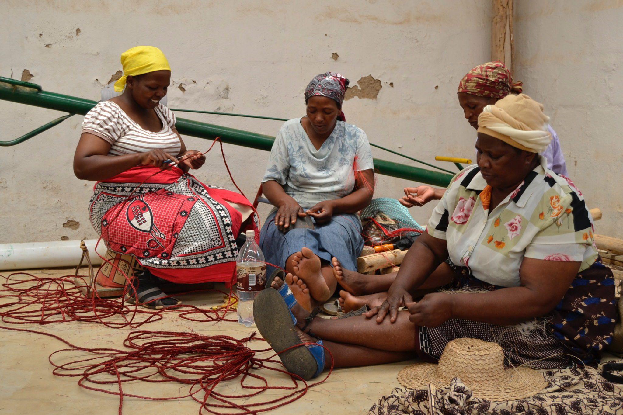 Ladies weaving baskets