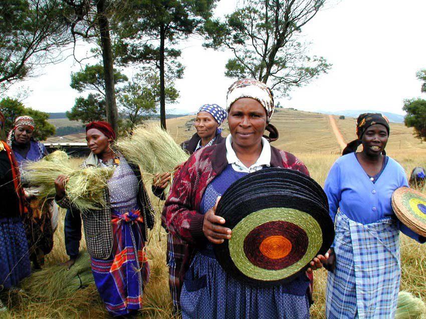African artisans carrying handmade placemats