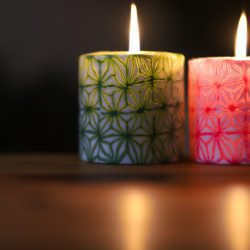 Green and pink lit candles