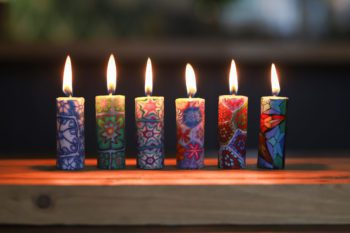 6 colourful lit candles