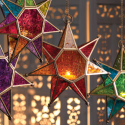 Colourful star tea light holders