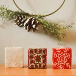 three xmas cube candles