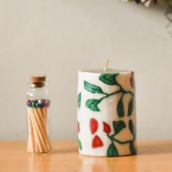 Mini pillar candle with holly design