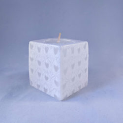 White fair trade mini cube candle with heart pattern