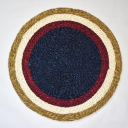 Fair trade hand woven placemat with blue, maroon and white concentric circles