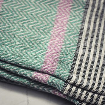 Close up of ethical peppermint green throw