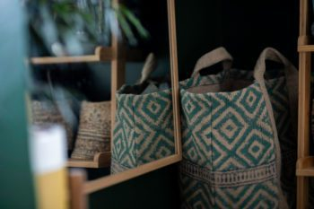Teal print laundry bag by mirror