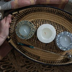two handled tray with candles in