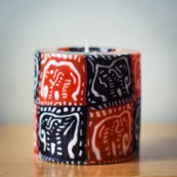 red and black pillar candle with elephant motif