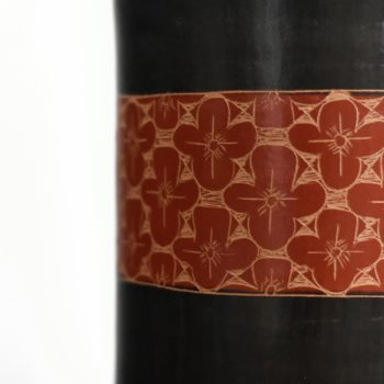 Detail of hand etched red flower pattern