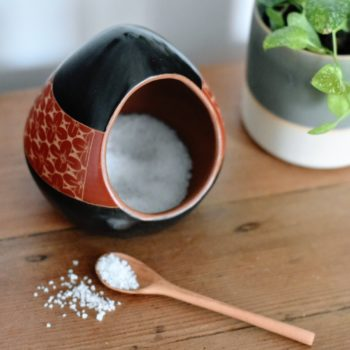 Fair trade salt cellar - black with rust red flower pattern and wooden spoon