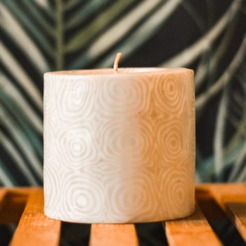 Candle with white swirl pattern