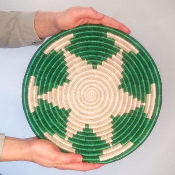 hand woven basket with green pattern