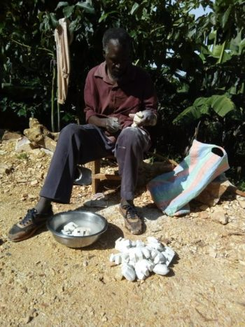 soapstone crafter working outside