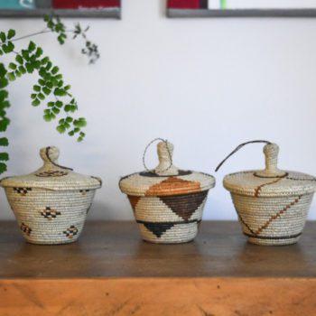 3 small ugandan storage baskets with lids