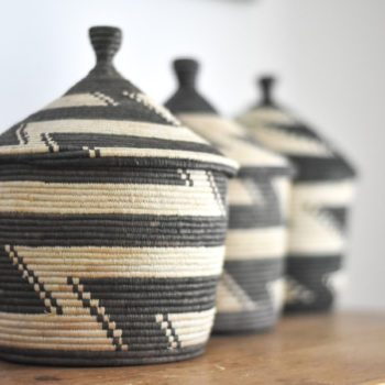 Row of black and white geometric pattern baskets from Uganda