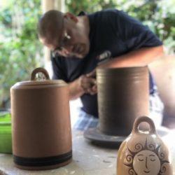 Artisan making ceramic bell