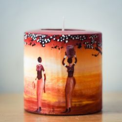 hand painted candle with 2 ladies walking into african sunset