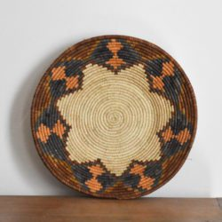 Ethical woven shallow bowl from Uganda with flower pattern