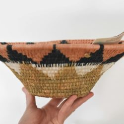 Hand holding african woven basket