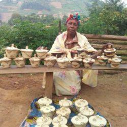 Artisan weaver displaying her baskets