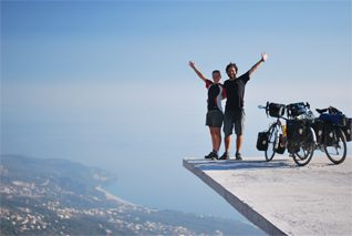 2 people standing at the edge of long drop in Albania